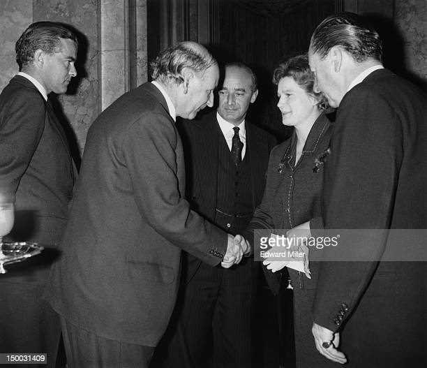 English physicist and radio astronomer Bernard Lovell shakes hands with Russian cosmonaut Valentina Tereshkova the first woman to have flown in space...