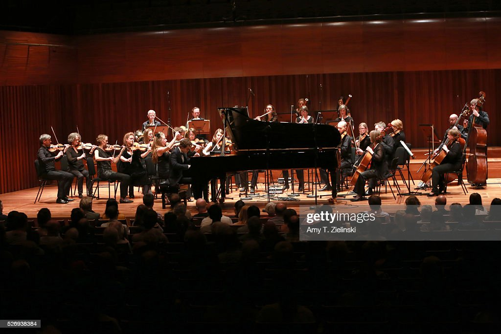 English pianist Benjamin Grosvenor directs while playing the piano the Britten Sinfonia in a performance of Mozart's last piano concerto at Milton Court Concert Hall on May 1, 2016 in London, England.