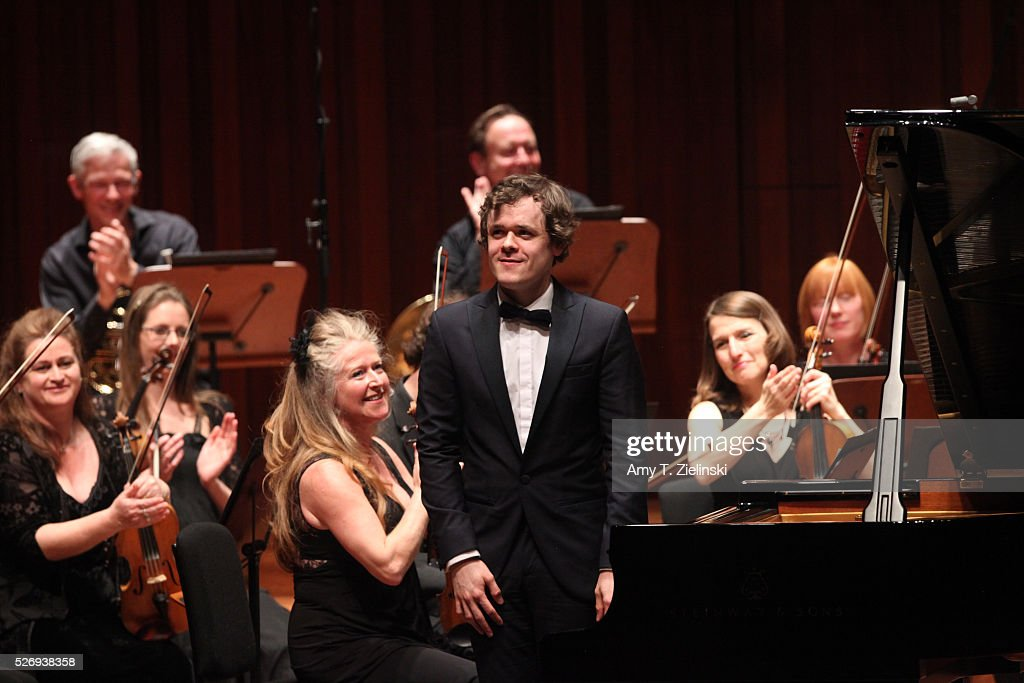 English pianist Benjamin Grosvenor receives the audience after directing while playing the piano with the Britten Sinfonia in a performance of Mozart's last piano concerto at Milton Court Concert Hall on May 1, 2016 in London, England.