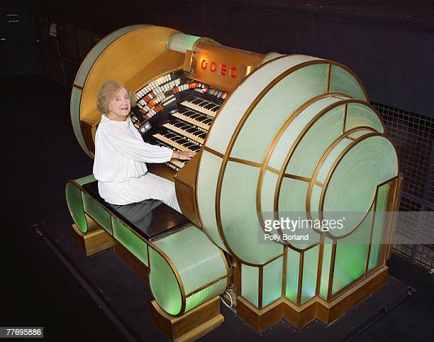 English pianist Ena Baga plays a theatre organ as an accompaniment to silent films circa 1995