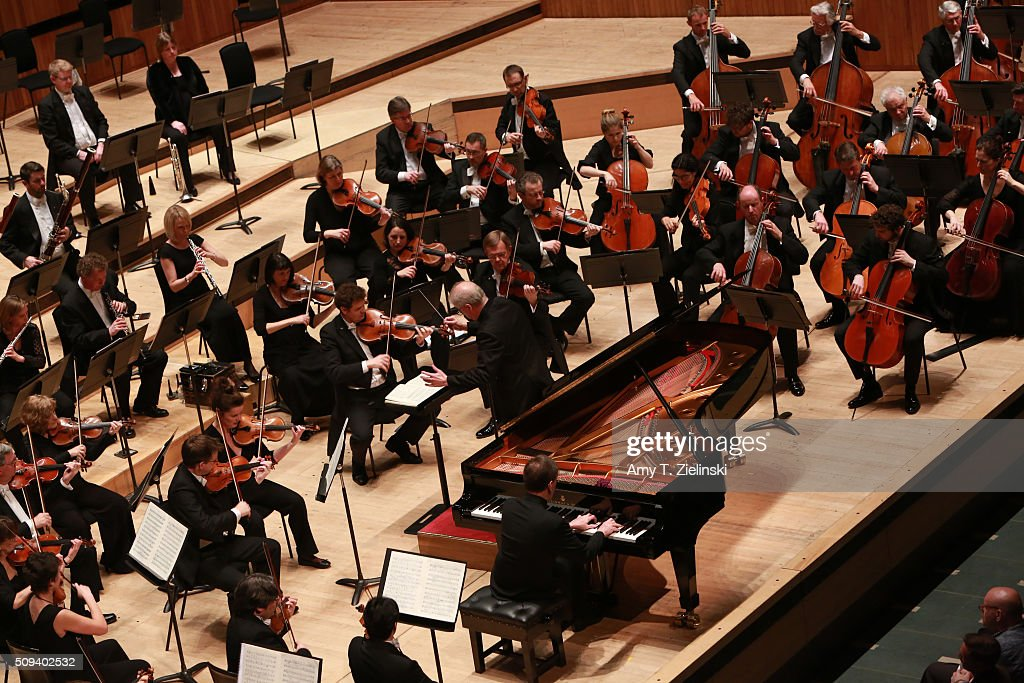 English pianist Stephen Hough plays the piano as Finnish conductor Osmo Vanska leads the London Philharmonic Orchestra in composer Antonin Dvorak's Piano Concerto in G minor in the Southbank Centre's the Royal Festival Hall on February 10, 2016 in London, England.