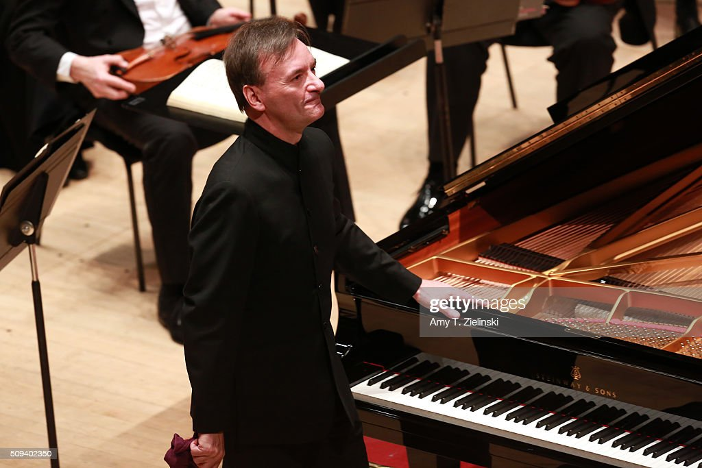 English pianist Stephen Hough receives applause after playing the piano while Finnish conductor Osmo Vanska lead the London Philharmonic Orchestra in composer Antonin Dvorak's Piano Concerto in G minor in the Southbank Centre's the Royal Festival Hall on February 10, 2016 in London, England.