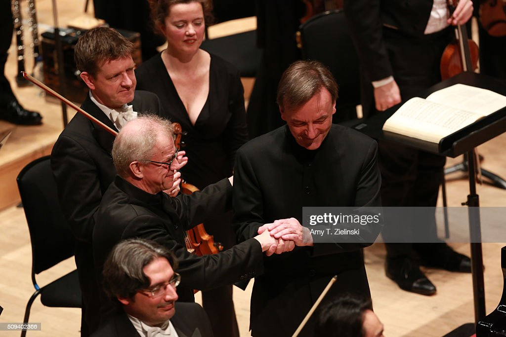 English pianist Stephen Hough receives applause after playing the piano and greets Finnish conductor Osmo Vanska (L) who lead the London Philharmonic Orchestra in composer Antonin Dvorak's Piano Concerto in G minor in the Southbank Centre's the Royal Festival Hall on February 10, 2016 in London, England.
