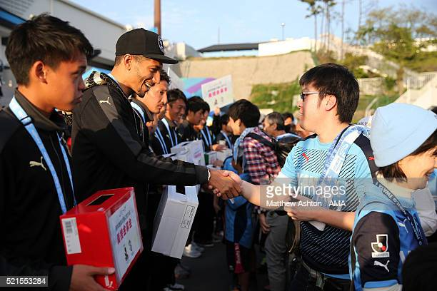 English player Jay Bothroyd of Jubilo Iwata shakes hands with a fan as he and other players collect money in aid of the Japan Earthquake appeal...