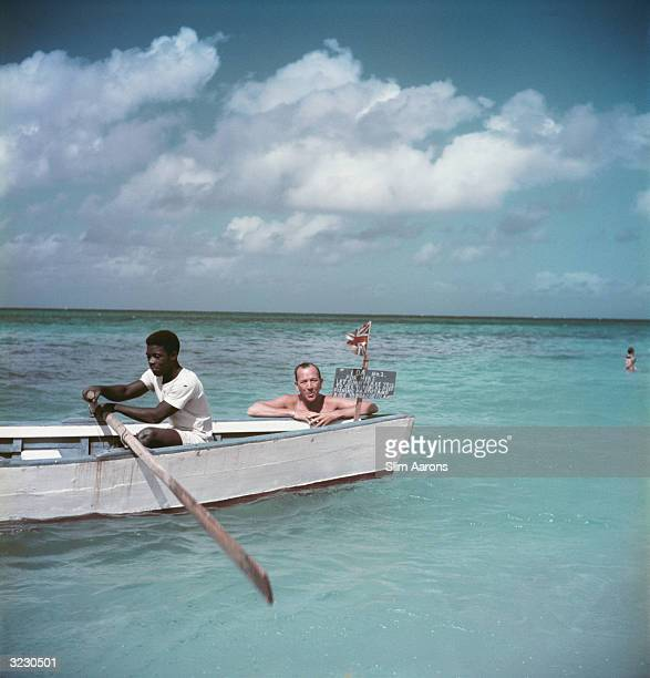 English playwright actor and composer Noel Coward on holiday in Jamaica in a hired rowing boat
