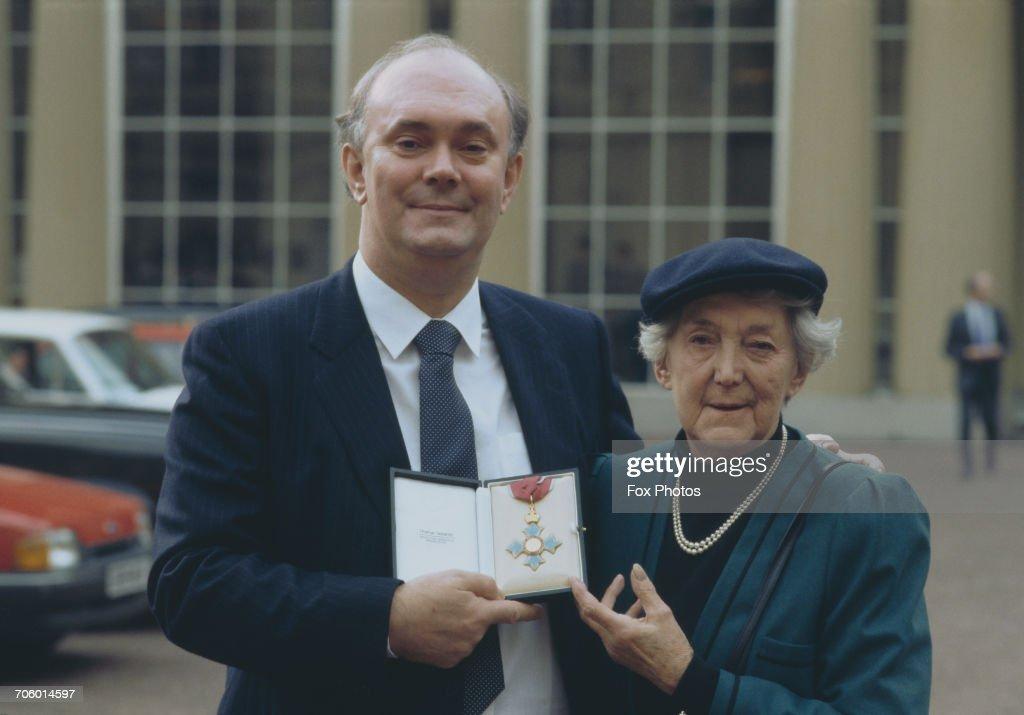 English playwright Alan Ayckbourn receives his CBE at Buckingham Palace, London, 11th February 1987.