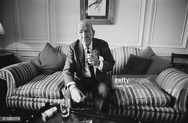 English playwright composer director actor and singer Noël Coward in London for the premiere of 'The Italian Job' in which he plays a part 30th May...