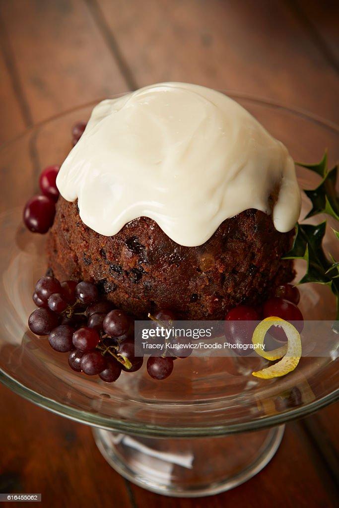 English plum pudding with custard sauce : Stock Photo
