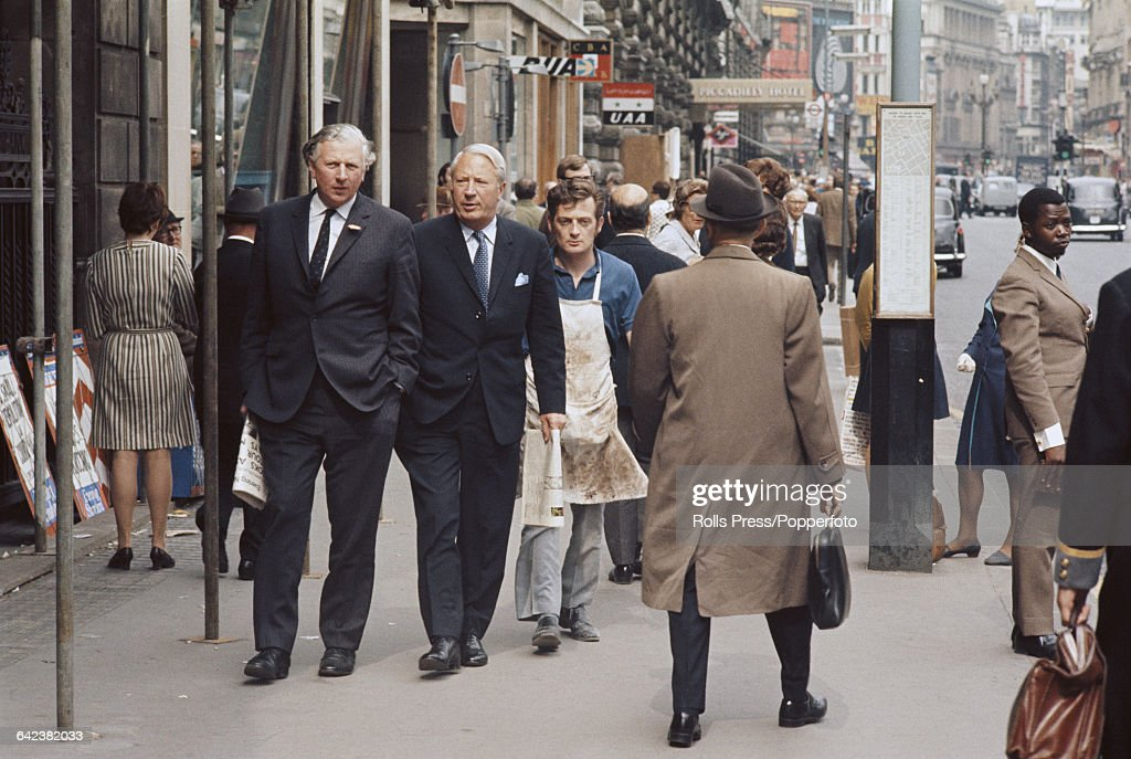 English politician and leader of the Conservative Party Edward Heath walks with fellow politician James Prior along Piccadilly in Westminster London...