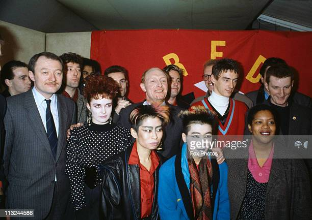 English politician Ken Livingstone Leader of the Greater London Council poses with Labour Party leader Neil Kinnock and singers Paul Weller and Billy...