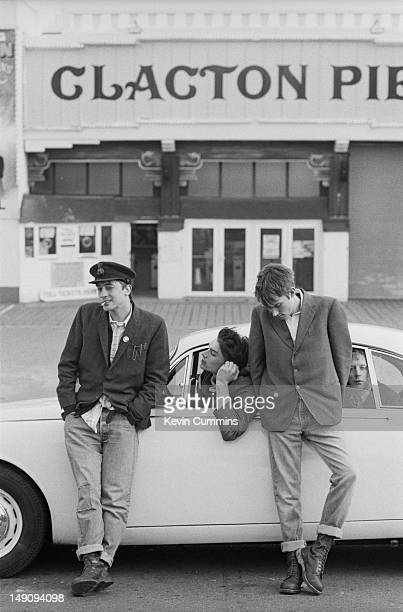 English pop group Blur pose with a Jaguar Mark 2 car by Clacton Pier in ClactononSea Essex March 1993 Left to right guitarist Graham Coxon bassist...