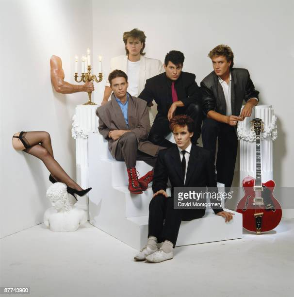 English pop group Duran Duran pose with pop art pieces April 1984 Clockwise from top left bassist John Taylor drummer Roger Taylor singer Simon Le...