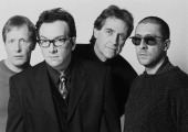 English pop group Elvis Costello And The Attractions London 1994 Left to right bassist Bruce Thomas singer and guitarist Elvis Costello drummer Pete...