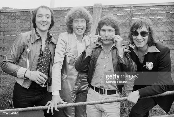 English pop group Mud at Brands Hatch Kent August 1974 Left to right drummer Dave Mount guitarist Rob Davis bassist Ray Stiles and singer Les Gray