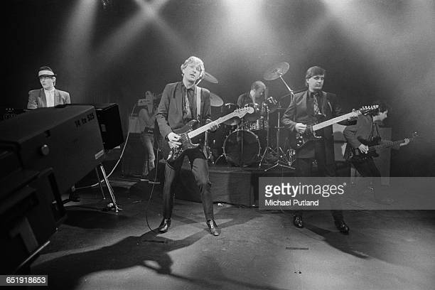 English pop group Squeeze at a video shoot 1982 Left to right Don Snow Glenn Tilbrook Gilson Lavis Chris Difford and John Bentley