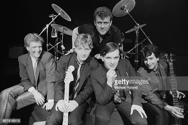 English pop group Squeeze at a video shoot 1982 Left to right keyboard player Don Snow singer and guitarist Glenn Tilbrook drummer Gilson Lavis...