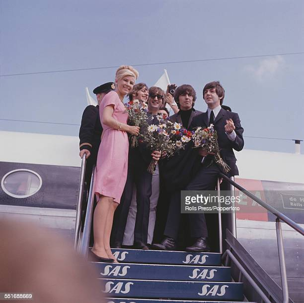 English pop group The Beatles arrive at the airport in Stockholm Sweden on 28th July 1964 prior to their performances over two nights at the ice...