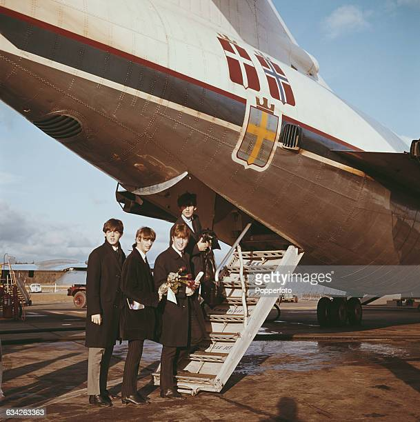 English pop group The Beatles board the rear steps of an SAS airlines plane at Stockholm airport in Sweden for their return journey back to London on...