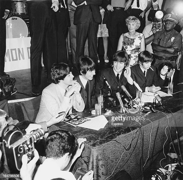 English pop group The Beatles giving a press conference at the Hollywood Bowl Los Angeles California 23rd August 1964 Left to right Paul McCartney...