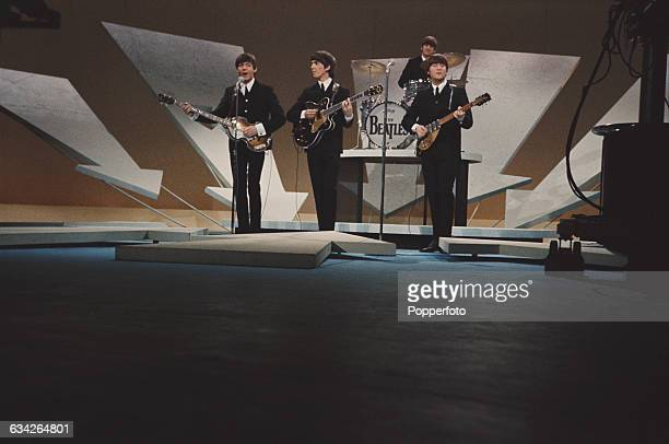 English pop group The Beatles perform before television cameras on The Ed Sullivan Show at CBS's Studio 50 in New York City on 9th February 1964 The...