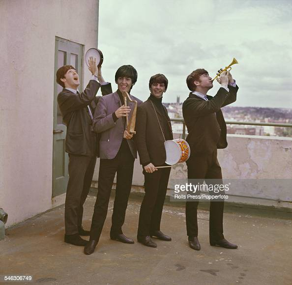 English pop group The Beatles pictured playing children's musical instruments on the roof of a building in London in 1964 From left to right Paul...