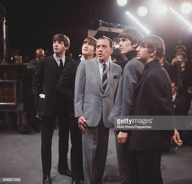 English pop group The Beatles pictured with American television talk show host Ed Sullivan during a recording session for The Ed Sullivan Show in New...