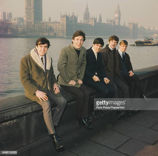 English pop group The Dave Clark Five posed on the river Thames embankment opposite the Palace of Westminster in London circa 1964 From left to right...