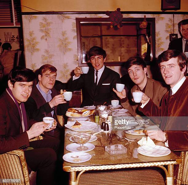 English pop group The Dave Clark Five posed together in a cafe in London in 1964 From left to right Denis Payton Lenny Davidson Dave Clark Mike Smith...