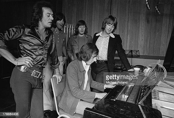 English pop group The Hollies in a recording studio 1st September 1973 Left to right singer Allan Clarke guitarist Terry Sylvester drummer Bobby...