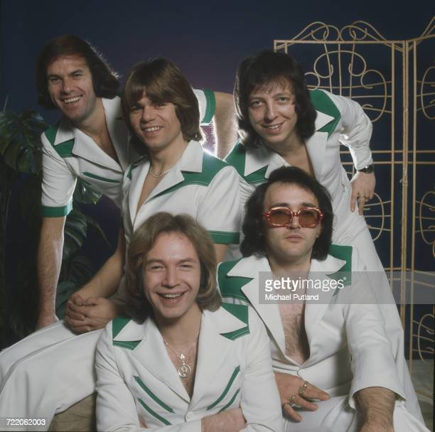English pop group The Rubettes posed in matching outfits 23rd December 1975 Clockwise from top left bassist Mick Clarke drummer John Richardson...