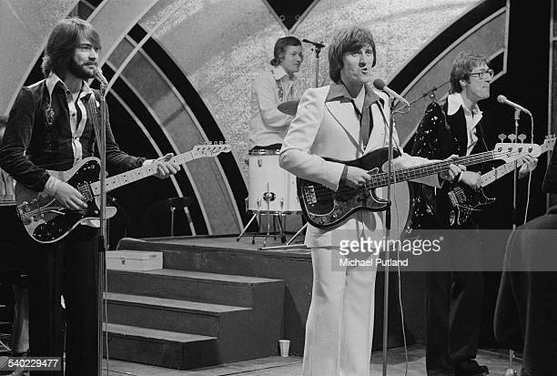 English pop group The Shadows performing on the BBC TV music show 'Top Of The Pops' 27th March 1975 Left to right John Farrar Bruce Welch Brian...