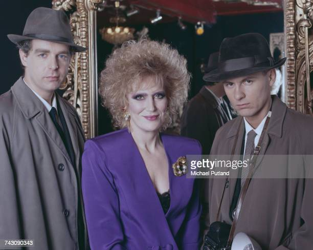 English pop singer Dusty Springfield posed with Neil Tennant and Chris Lowe of the Pet Shop Boys dressed as 1960s journalists studio portrait...