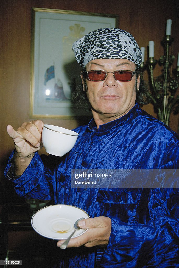 English pop singer <a gi-track='captionPersonalityLinkClicked' href=/galleries/search?phrase=Gary+Glitter&family=editorial&specificpeople=228004 ng-click='$event.stopPropagation()'>Gary Glitter</a> takes tea at the Silver Clef Awards in London, 20th June 1997.