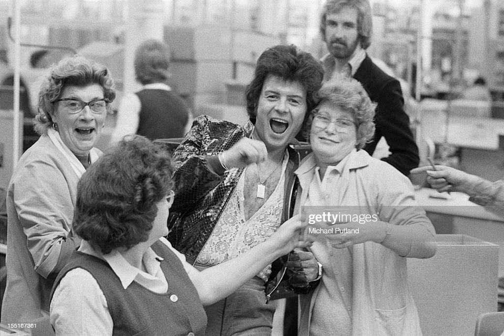 English pop singer Gary Glitter with fans, 9th April 1974.