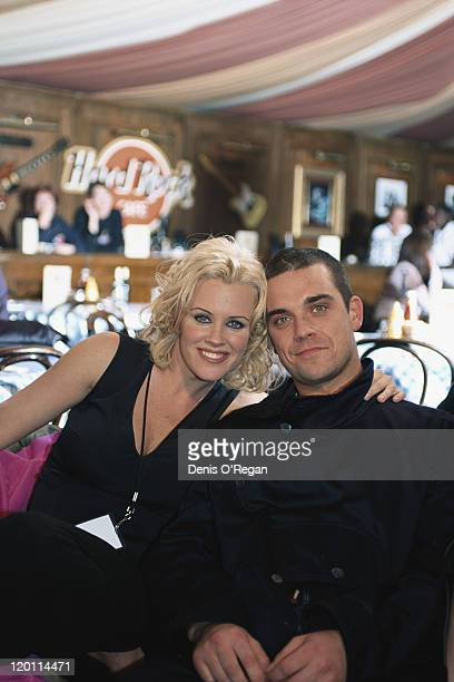 English pop singer Robbie Williams with American model and comedian Jenny McCarthy at the MTV Europe Music Awards at the Fila Forum Milan 12th...