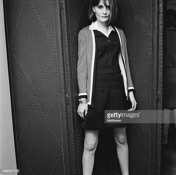 English pop singer Sandie Shaw models a skirt blouse and cardigan by Daniel Hechter January 1967