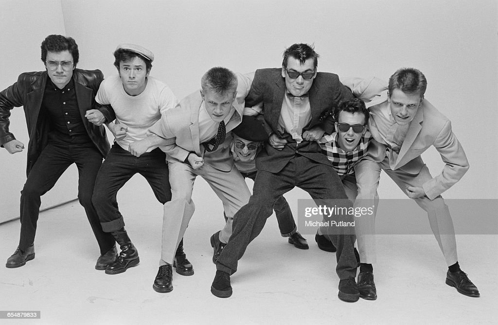 English pop/ska band Madness, during the cover shoot for their album '7', London, 1981. Left to right: Chris Foreman, Lee Thompson, Chas Smash, Daniel Woodgate, Mike Barson, Mark Bedford and Suggs.