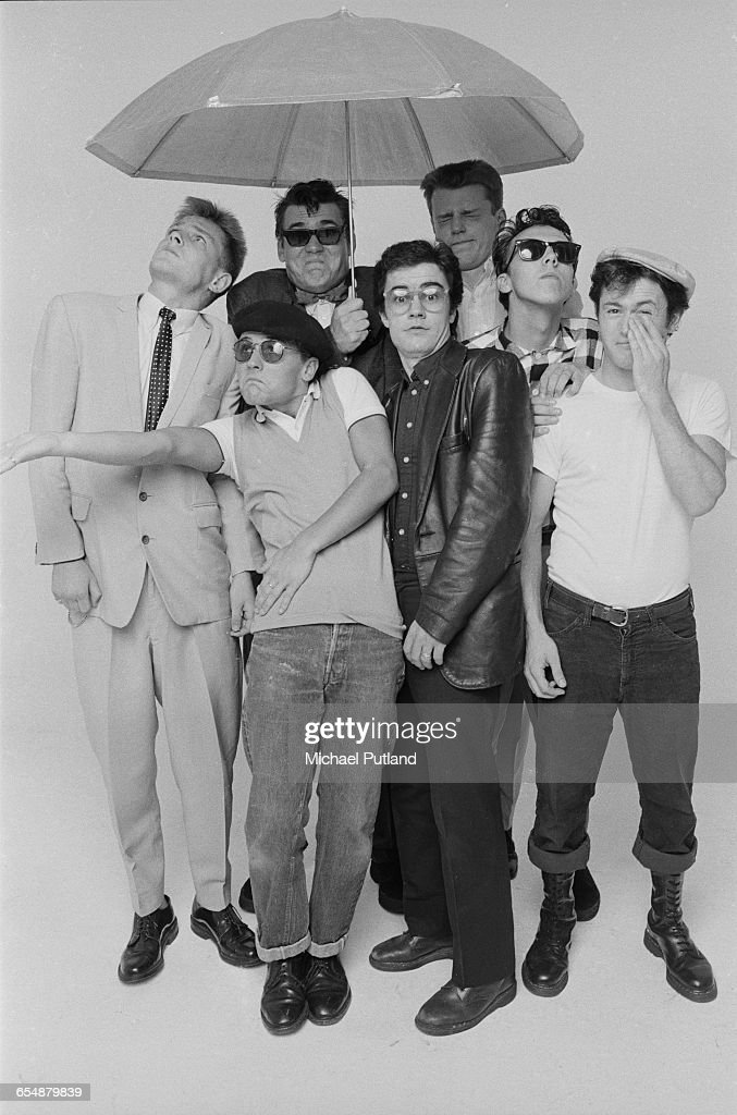 English pop/ska band Madness, during the cover shoot for their album '7', London, 1981. Left to right: Chas Smash, Daniel Woodgate (front), Mike Barson, Chris Foreman, Suggs, Mark Bedford and Lee Thompson.