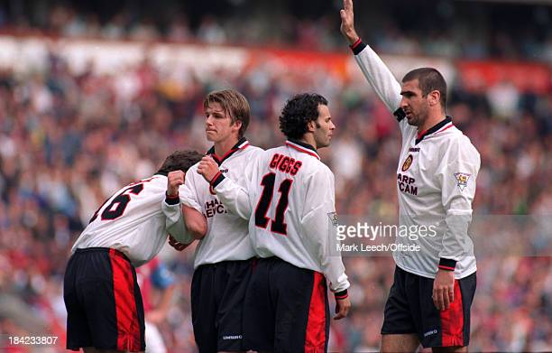 English Premier League Aston Villa v Manchester United Eric Cantona and David Beckham of Manchester United look to Peter Schmeichel in goal for the...
