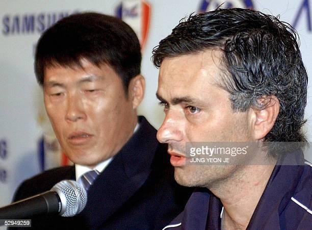 English Premier League champion Chelsea coach Jose Mourinho answers a question as South Korean football team Suwon coach Cha BumKun during a press...