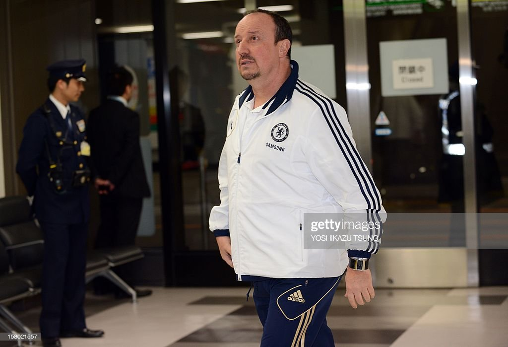 English Premier League football team Chelsea head coach Rafael Benitez arrives with the team at Narita International Airport in Narita, suburban Tokyo on December 9, 2012. Chelsea will play a semi-final match in the Club World Cup tournament in Yokohama on December 13. AFP PHOTO / Yoshikazu TSUNO