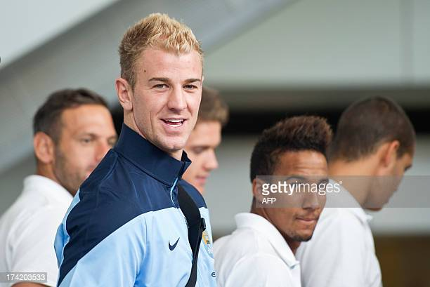 English Premier League football team Manchester City and England goal keeper Joe Hart and midfielder Scott Sinclair arrive in Hong Kong on July 22...