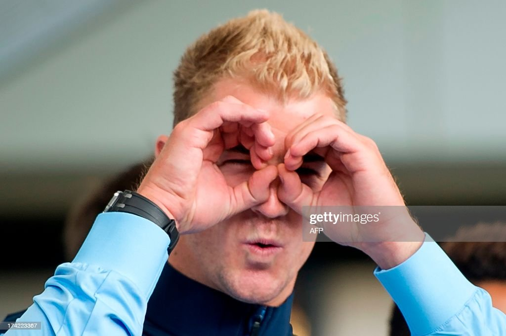 English Premier League football team Manchester City and England goal keeper Joe Hart gestures after his arrival in Hong Kong on July 22, 2013. Manchester City will be playing local team South China on July 24. AFP PHOTO / ANTHONY WALLACE