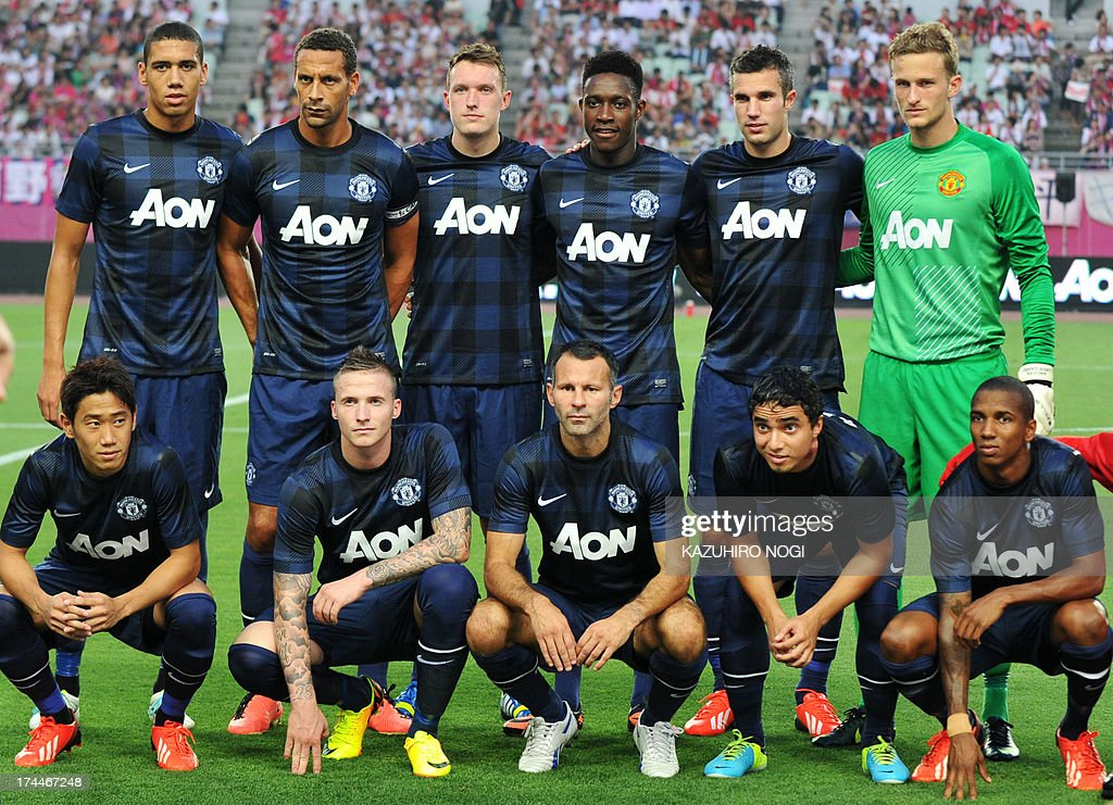 English Premier League Manchester United players (front row, L-R) Shinji Kagawa, Alexander Buttner, Ryan Giggs, Rafael de Silva, Ashley Young, (2nd row, L-R) Chris Smalling, Rio Ferdinand, Phil Jones, Danny Welbeck, Robin van Persie, and Anders Lindegaard, pose for a photo before a friendly football match against Japan's Cerezo Osaka at Nagai Stadium in Osaka on July 26, 2013. Manchester United and Cerezo Osaka finished in a draw of 2-2.