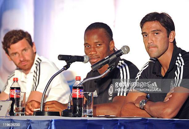 English Premier League team Chelsea player Paulo Ferreira speaks during a press conference next to teammate Didier Drogba and new manager Andre...