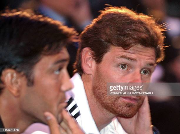 English Premier League team Chelsea's new manager Andre VillasBoas sits next to his player Paulo Ferreira prior to a press conference in Bangkok on...