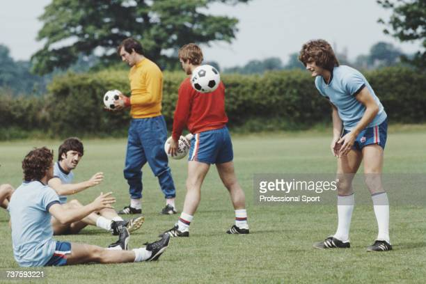 English professional footballer and midfielder with Tottenham Hotspur Glenn Hoddle pictured on right during a training session with the England...
