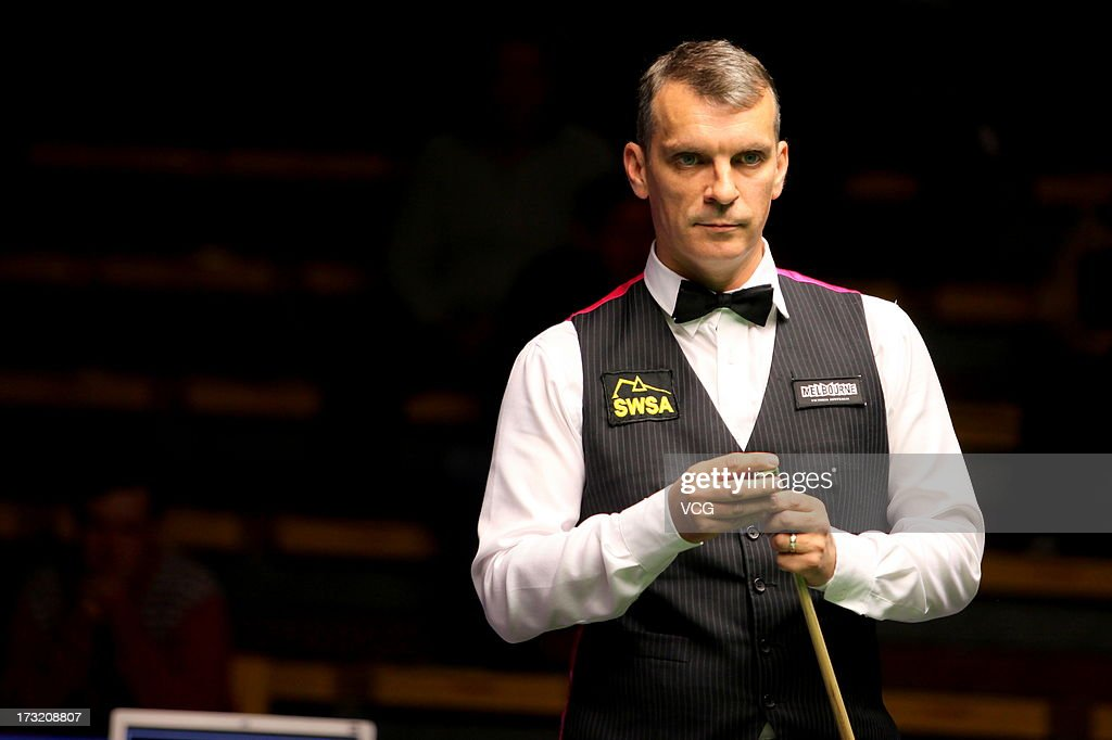 English professional snooker player <a gi-track='captionPersonalityLinkClicked' href=/galleries/search?phrase=Mark+Davis+-+Snooker+Player&family=editorial&specificpeople=11308246 ng-click='$event.stopPropagation()'>Mark Davis</a> looks on during the match against Pickering professional snooker player Paul S. Davidson on day two of the World Snooker Australia Open on July 10, 2013 in Bendigo, Australia.