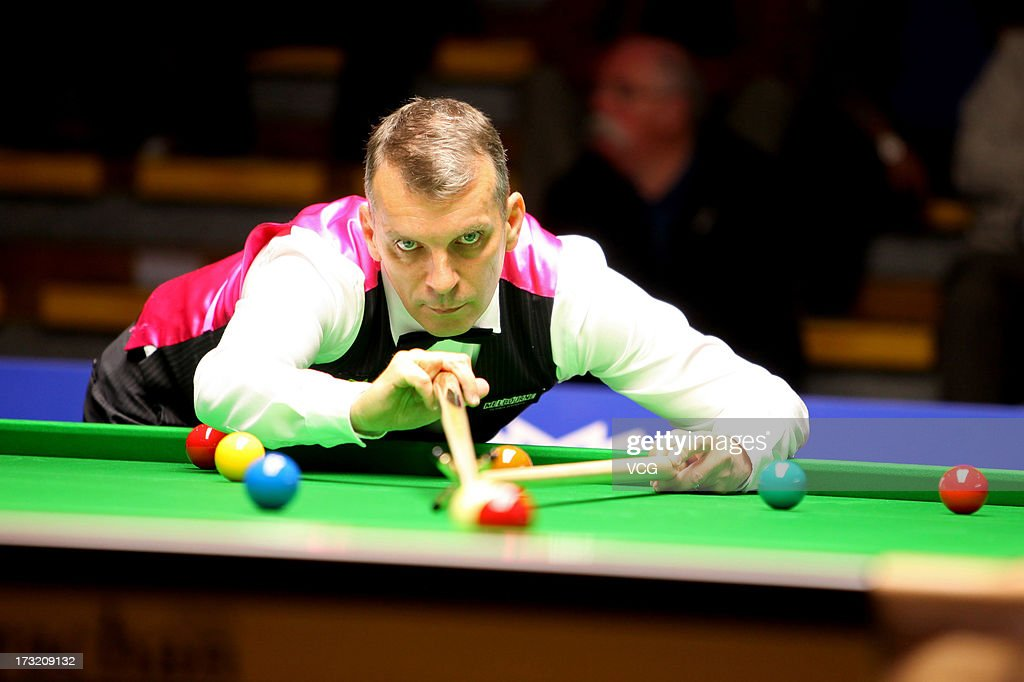 English professional snooker player Mark Davis plays a shot during the match against Pickering professional snooker player Paul S. Davidson on day two of the World Snooker Australia Open on July 10, 2013 in Bendigo, Australia.