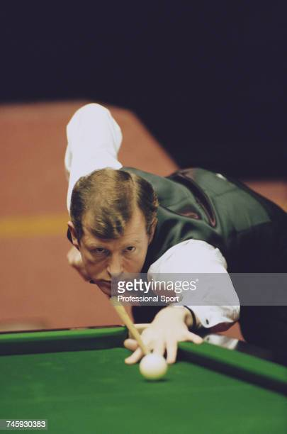 English professional snooker player Steve Davis pictured in action during competition in the 1996 Embassy World Snooker Championship at the Crucible...